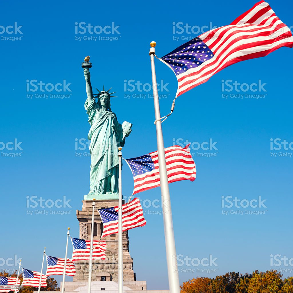 Statue of Liberty Surrounded by American Flags stock photo