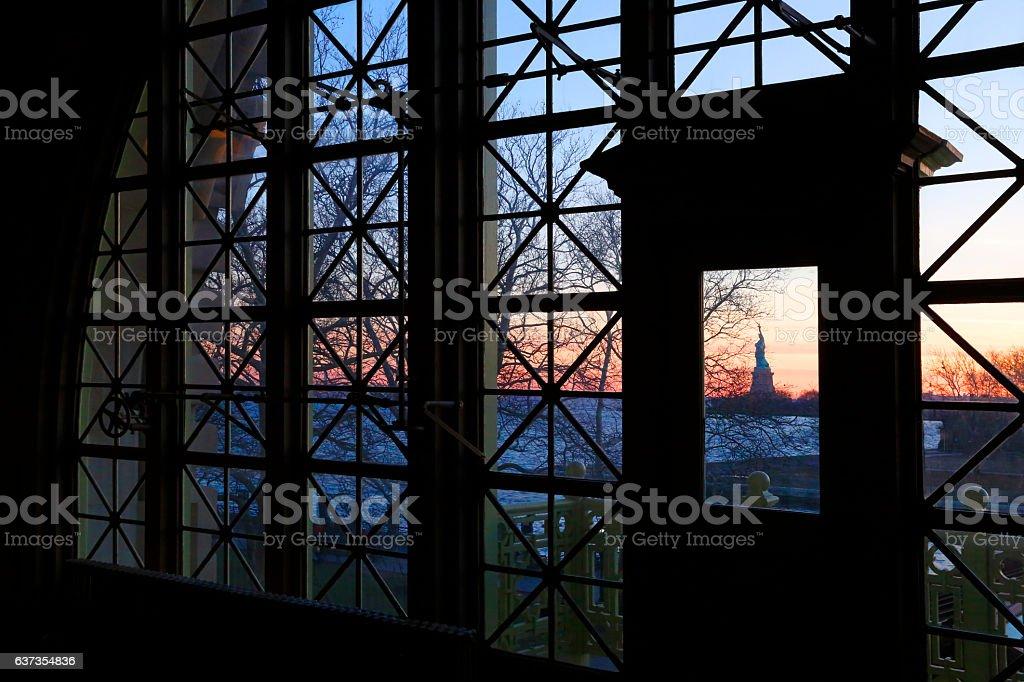 Statue Of Liberty Through Windows Of Ellis Island Immigration Station stock photo