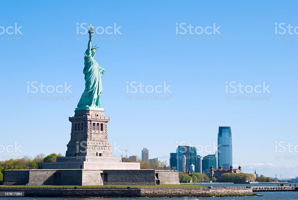 Statue of Liberty with New Jersey in the background royalty-free stock photo