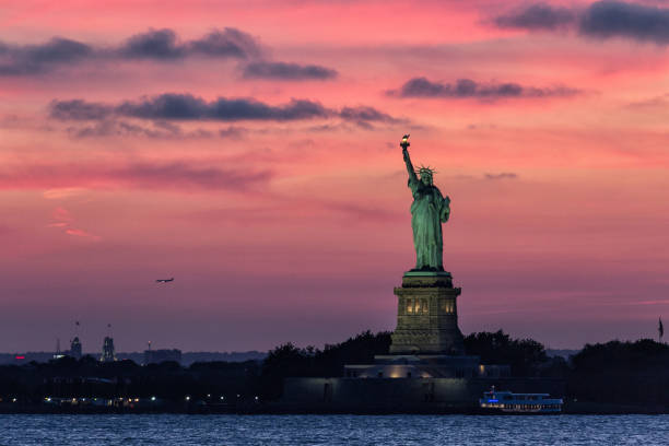 Statue of Liberty with Pink Sunset stock photo