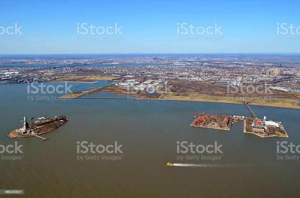 Statue of Libery and Ellis Island stock photo