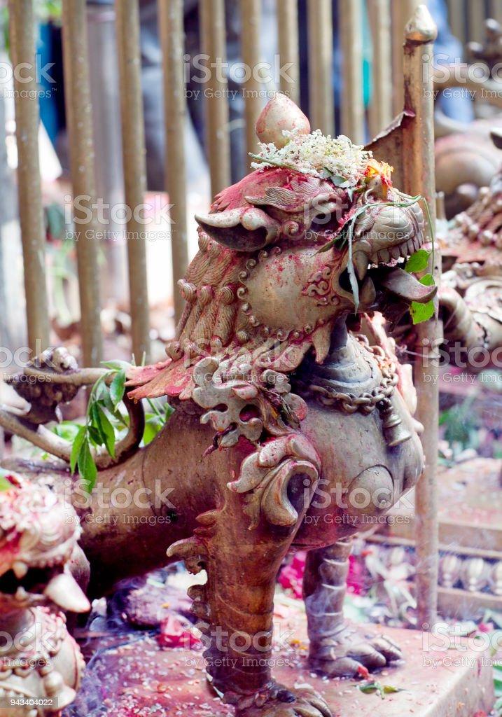 Statue of lion at Dakshinkali Hindu Temple in Pharping, Nepal stock photo