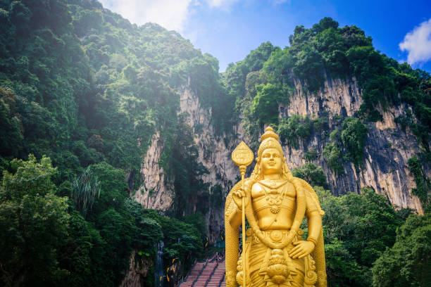 Statue of Lord Muragan and entrance at Batu Caves in Kuala Lumpur, Malaysia. Statue of Lord Muragan and entrance at Batu Caves in Kuala Lumpur, Malaysia. kuala lumpur batu caves stock pictures, royalty-free photos & images