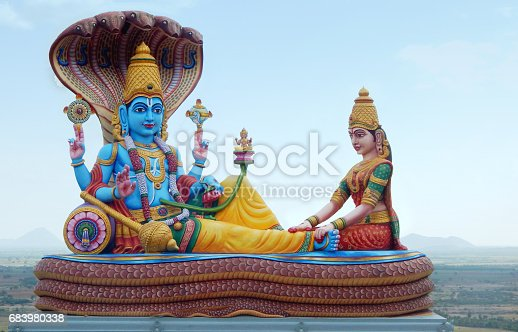 istock Statue of Lord vishnu and lakshmi Hindu God and goddess as in mythology in temple,India 683980338