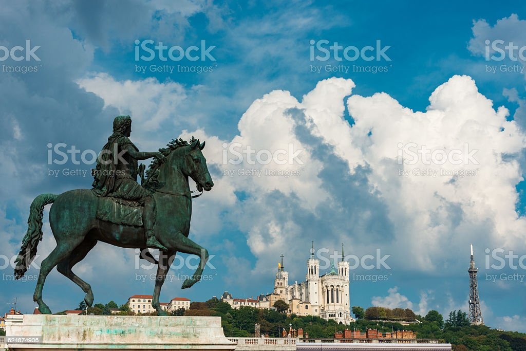 Statue of Louis XIV and basilica in Lyon stock photo