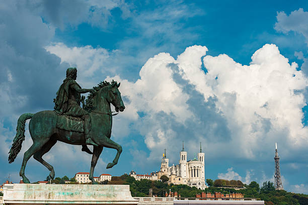 Statue of Louis XIV and basilica in Lyon - Photo