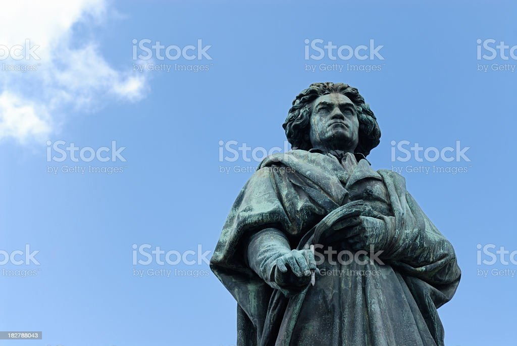 Statue of Ludwig van Beethoven against the bright blue sky stock photo