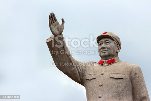 LIJIANG, CHINA, MARCH 8, 2012: Statue of Mao Zedond in central Lijiang. The city is famous for its UNESCO Heritage Site, the Old Town of Lijiang.