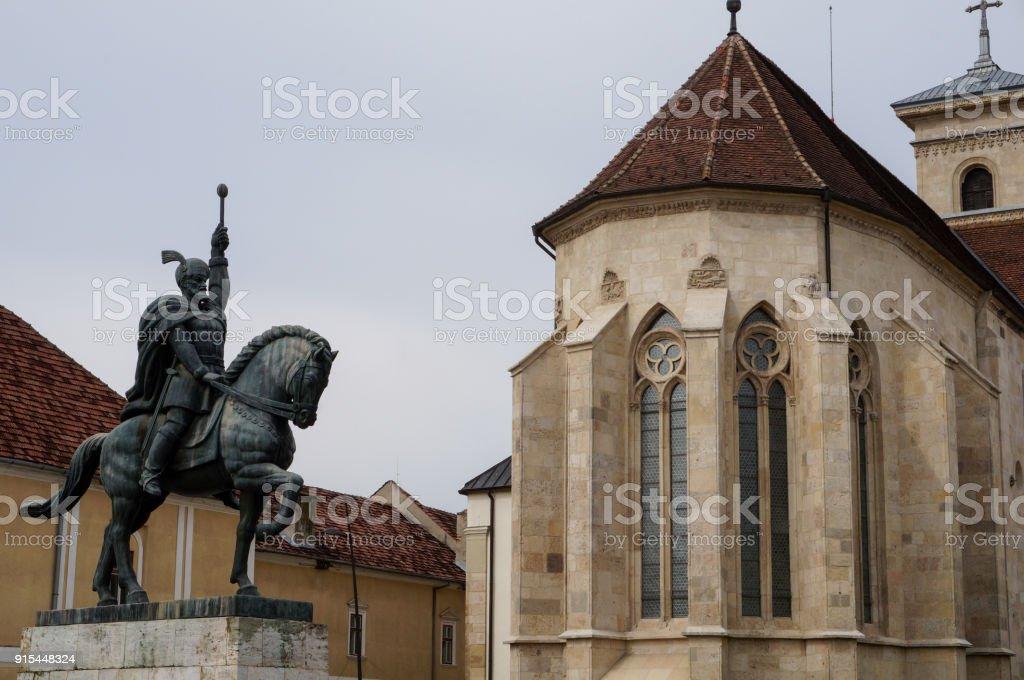 Statue of Mihai the Brave and Cathedral in Alba Iulia, Romania stock photo