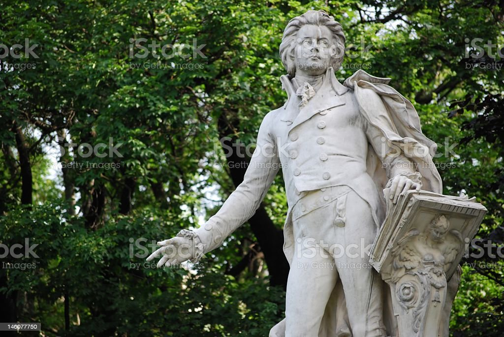 Statue of Mozart in front of trees royalty-free stock photo