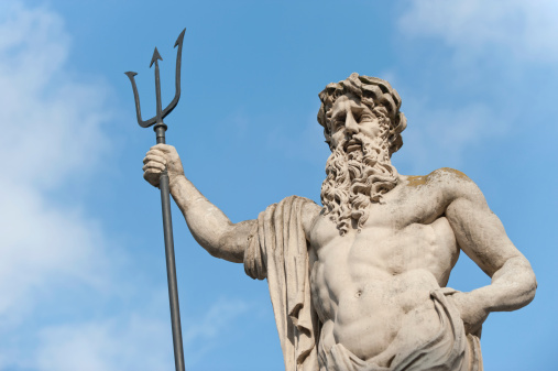 A Statue Of Neptune With A Blue Sky And Clouds Stock Photo - Download Image Now