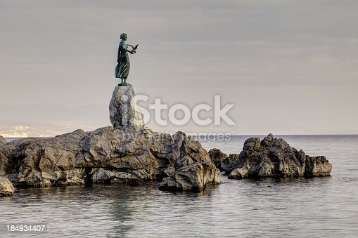 Historic statue on the rocks, symbol of Opatija-Croatia