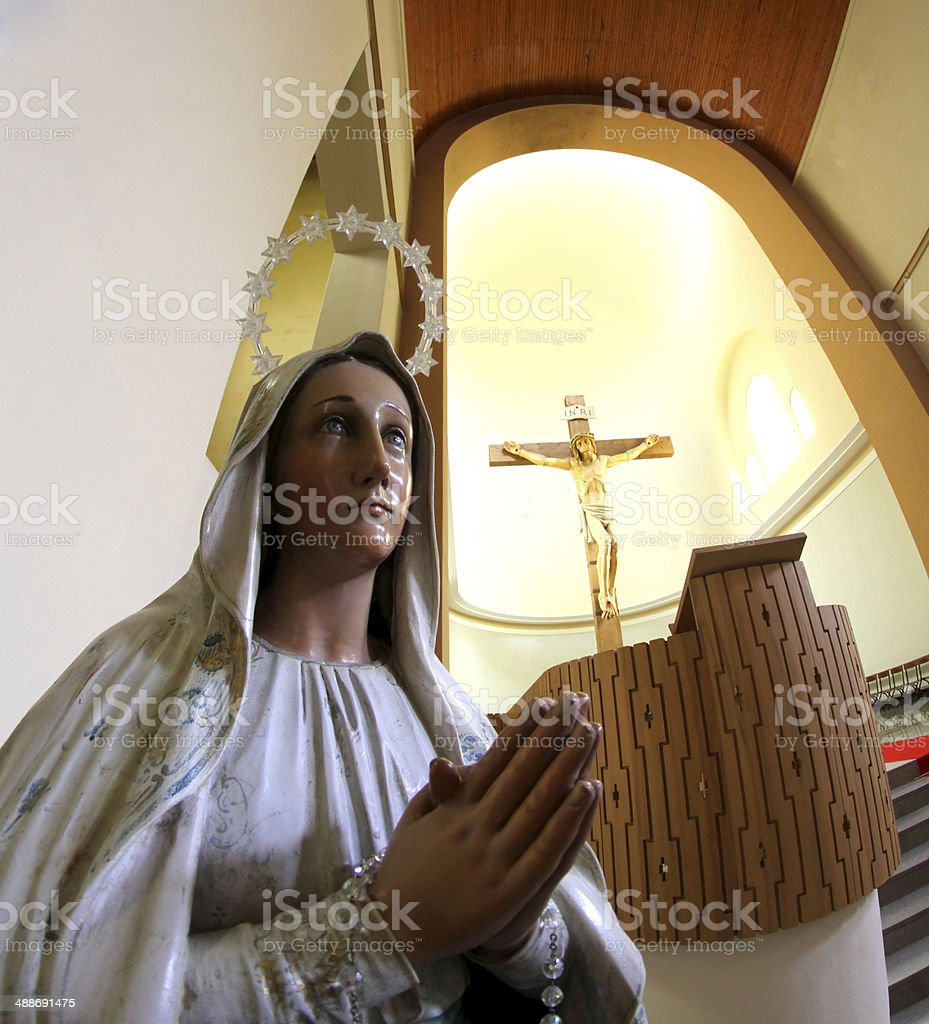 Statue of our Lady of sorrows and the great crucifix stock photo
