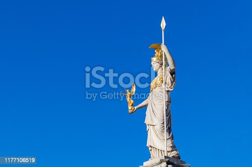 istock Statue of Pallas Athena Brunnen with blue sky near Parliament building in Vienna 1177106519