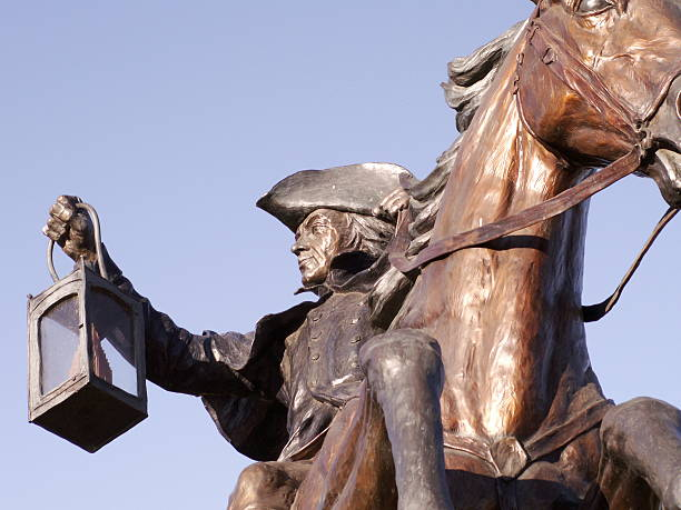 A statue of Paul revere on a horse stock photo
