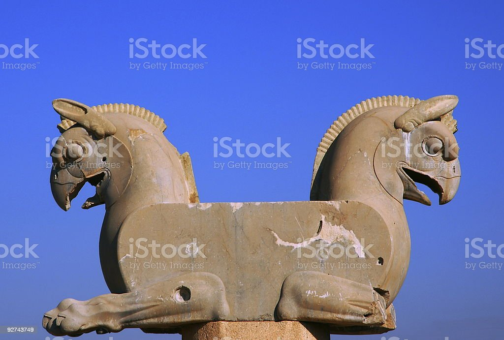 Statue of Persepolis in front of a clear blue sky stock photo