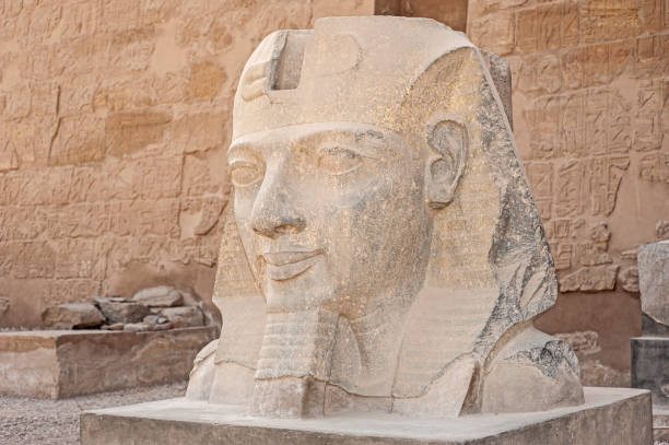 Statue of pharaoh head at an ancient egyptian temple stock photo