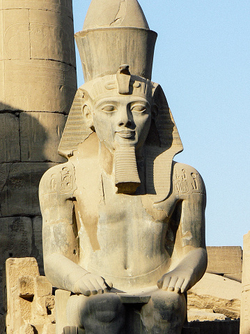 istock Statue of Pharaoh Ramses II in the great temple of Karnak dedicated to the cult of Amun, in the city of Luxor in Egypt 1249838876