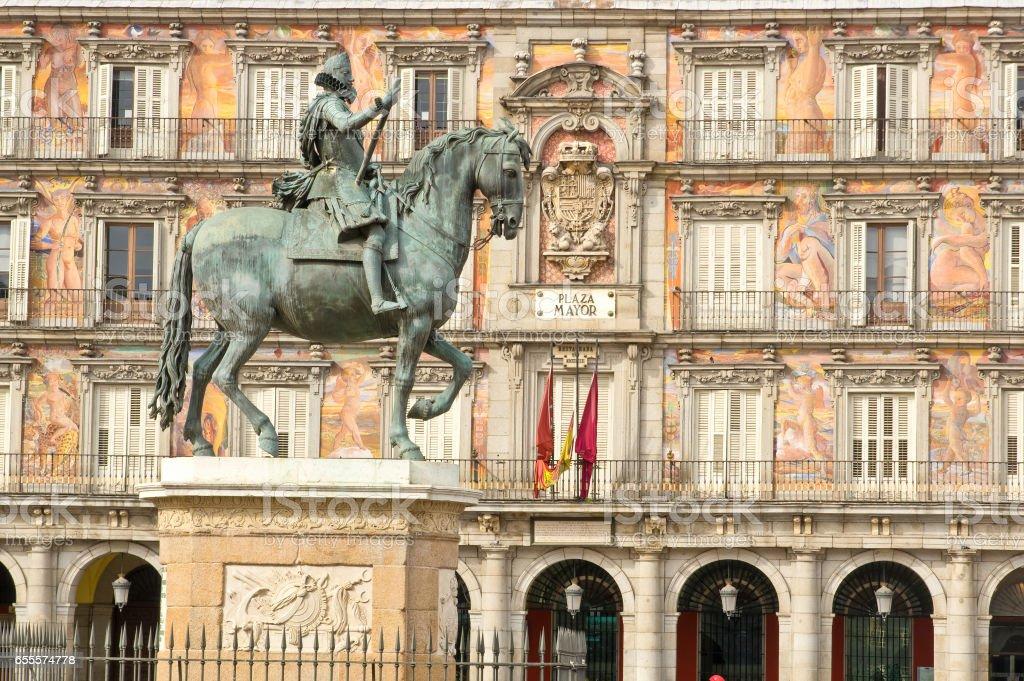Statue of Philip III with Bakery House (Casa de la Panaderia) on bakcground on Plaza Mayor in Madrid, Spain stock photo