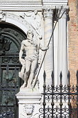 Statue of Poseidon in the front door of the Arsenal. Venice, Italy