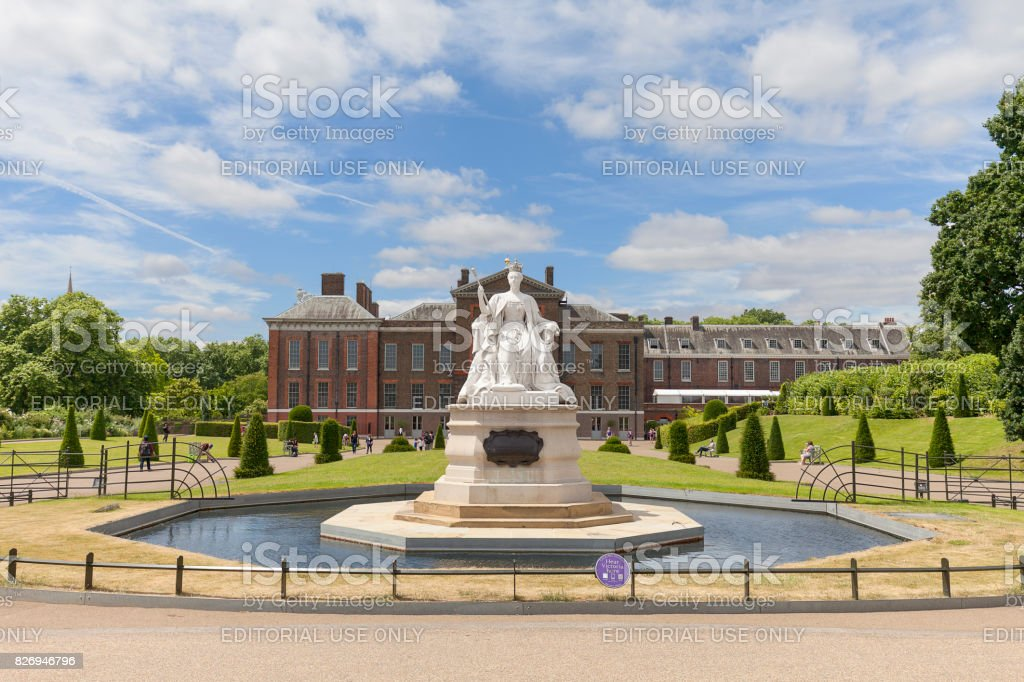 Statue of Queen Victoria and Kensington Palace in Kensington Gardens, London, United Kingdom stock photo