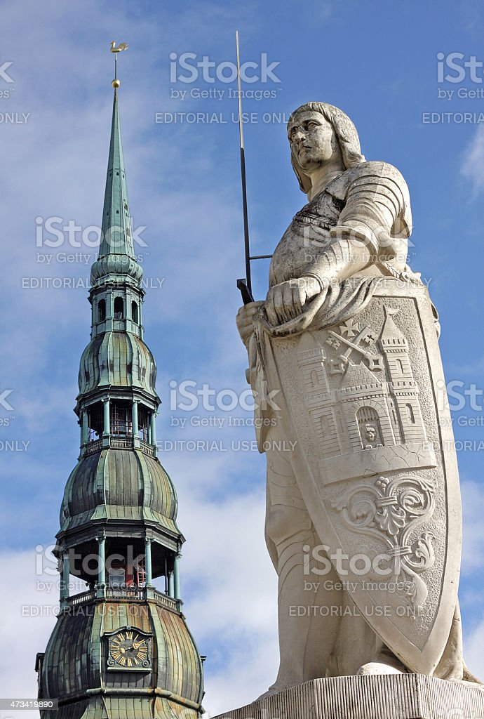 Statue of Roland and Church of St. Peter in Riga stock photo
