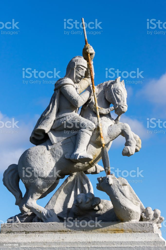 Statue of Saint George and the Dragon on Orkneys, Scotland. stock photo