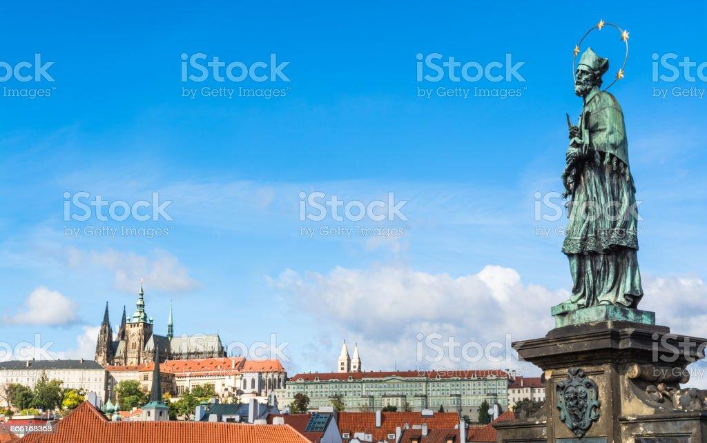 Statue of Saint John of Nepomuk on Charles Bridge in Prague stock photo