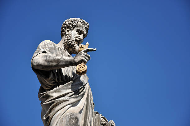 statue of saint peter in saint peter square. vatican city - peter the apostle stock photos and pictures