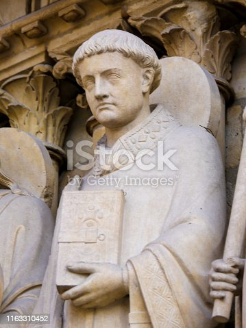 Medieval Statue of Saint Stephen at the Cathedral of Notre Dame, Paris, France.