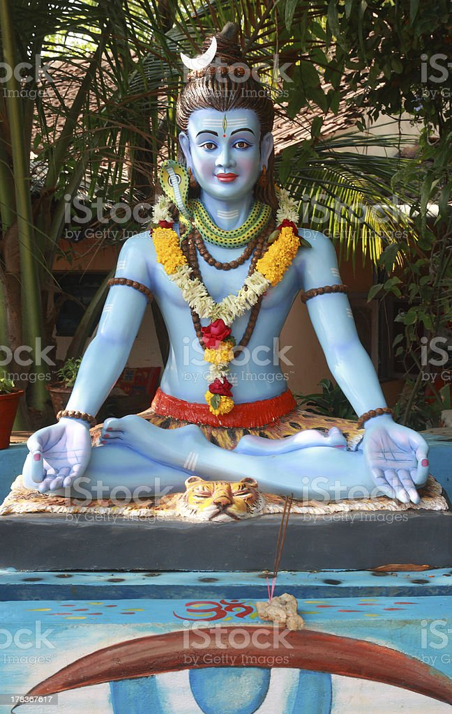 Statue of Shiva in the Indian courtyard home. royalty-free stock photo