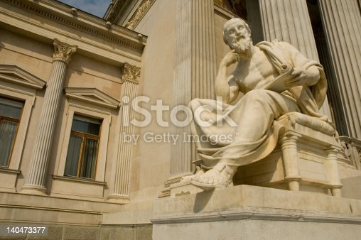 istock Statue of sitting philosopher on chair 140473377