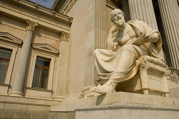 Statue of sitting philosopher on chair stock photo