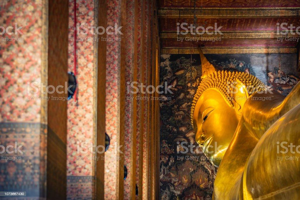Statue of Sleep Buddha or Reclining Buddha in Wat Pho Temple in Bangkok, Thailand – zdjęcie
