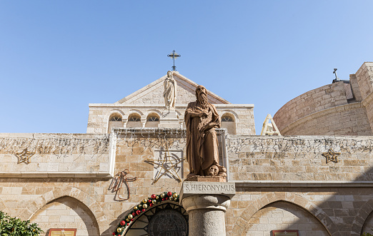 Statue of St. Hieronymus stands in the courtyard of the Chapel of Saint Catherine in Bethlehem in Palestine