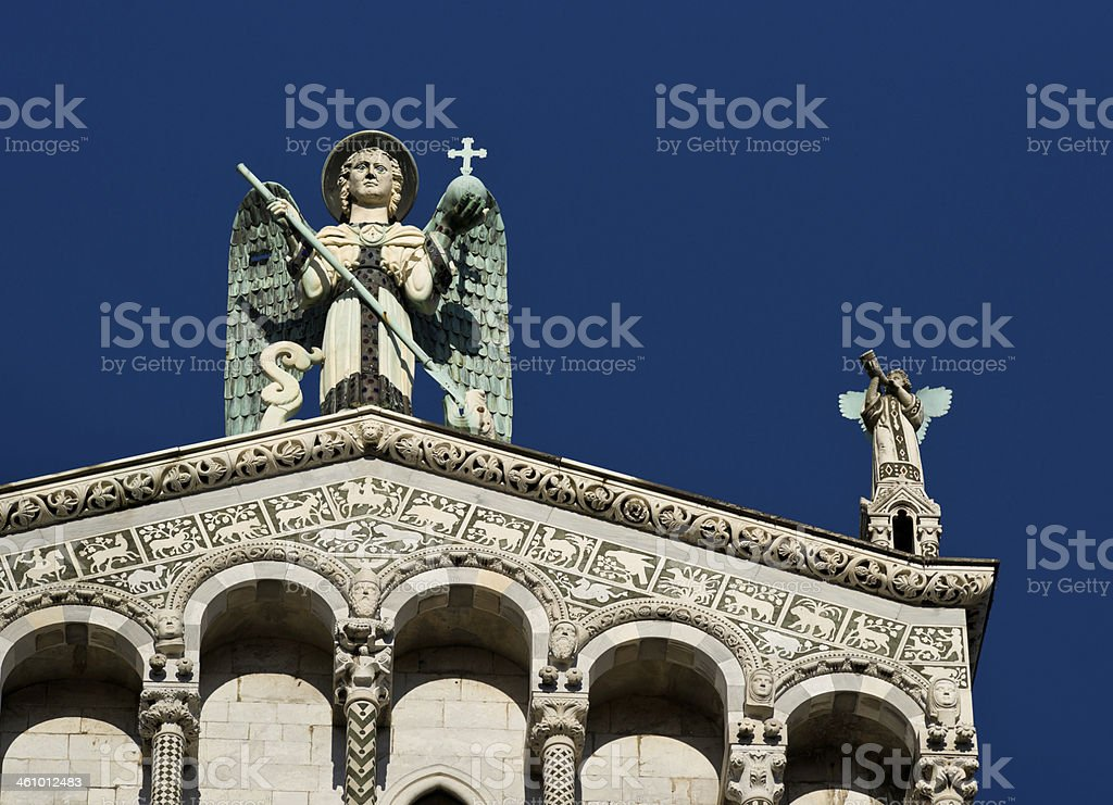 Statue of St. Michael Archangel from San Michele Foro Lucca stock photo