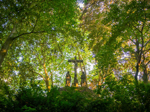 Statue of the crucifixion of Jesus in a forest stock photo
