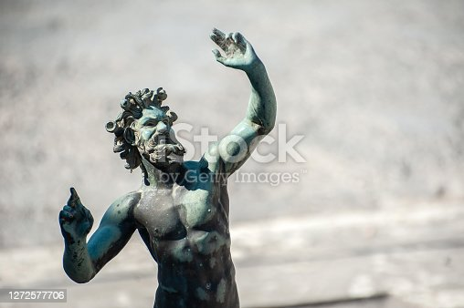 POMPEII, ITALY - JUNE 25, 2017 - Statue of the Dancing Faun at the House of the Faun, Pompeii, Italy