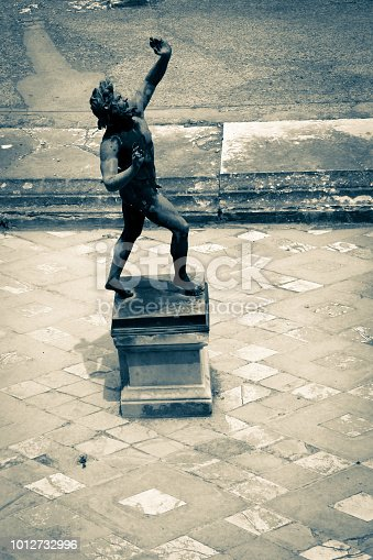 istock Statue of the Dancing Faun in the House of the Faun in Pompeii, near Naples, Italy 1012732996