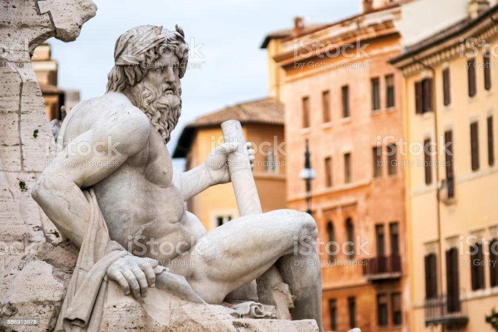Statue of the god Zeus in Bernini's Fountain in the Piazza Navona, Rome stock photo