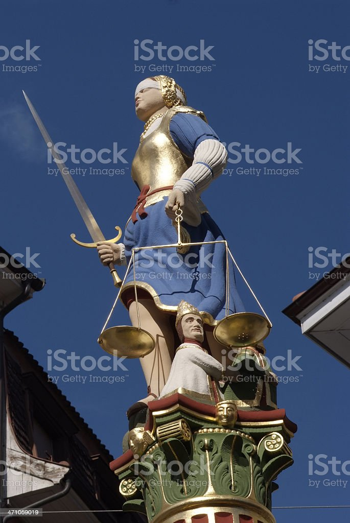 Statue of the justice Place de la 'Palud' in Lausanne royalty-free stock photo