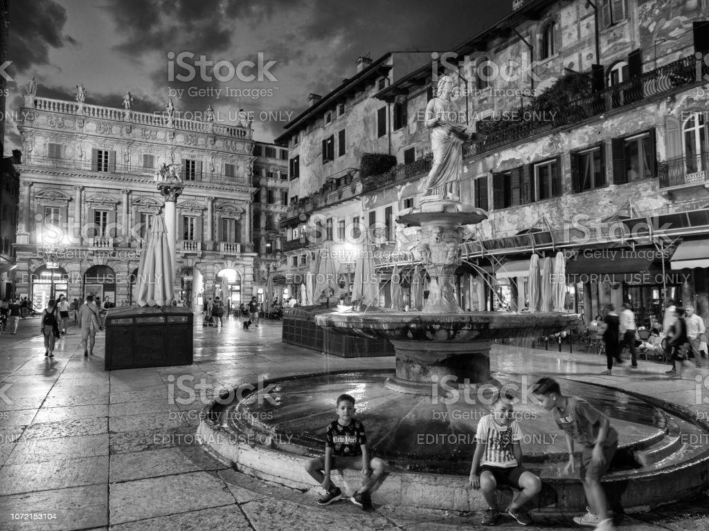 Statue of the Madonna on Piazza delle Erbe at Night, Verona, Veneto, Italy stock photo