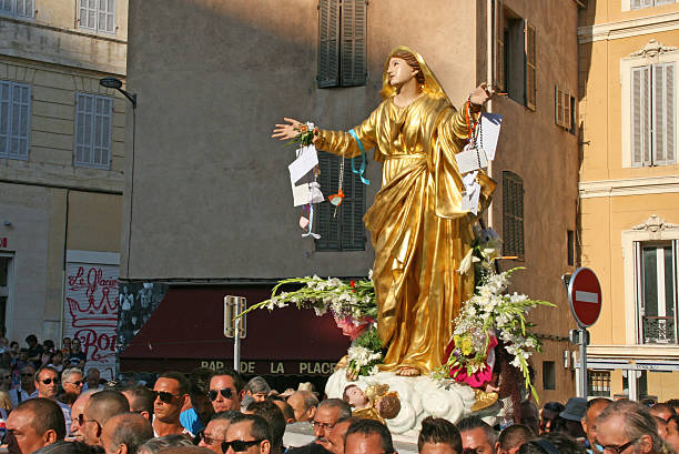 Statue of the virgin Mary, Assumption procession in Marseille, France. stock photo
