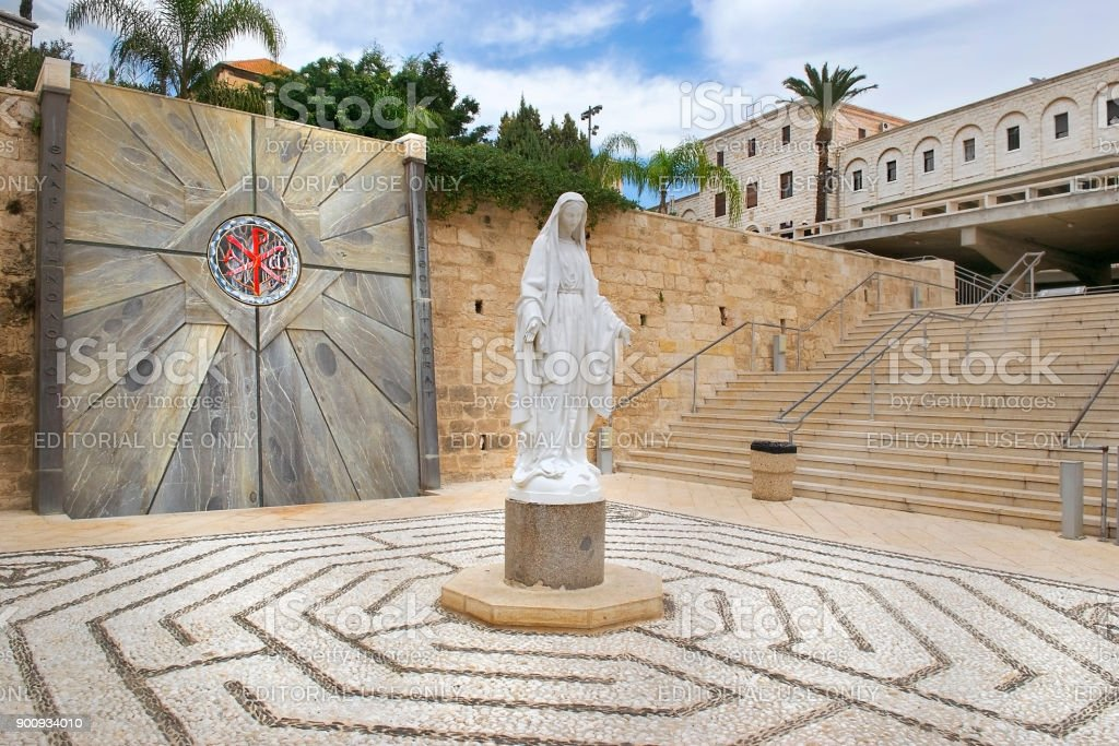 statue of the Virgin Mary in the courtyard of the Basilica of the Annunciation in Nazareth, Israel stock photo