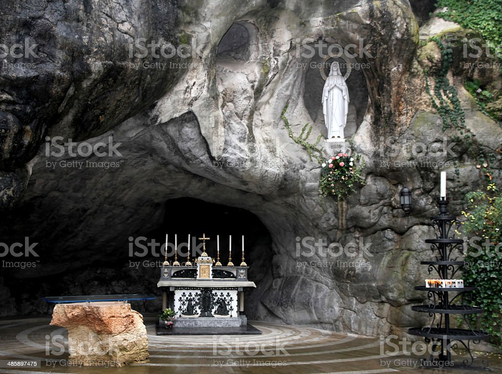 Statue of the Virgin Mary in the grotto of Lourdes stock photo