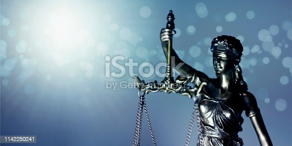 Statue of Themis - goddess of justice. Closeup image with copy space.