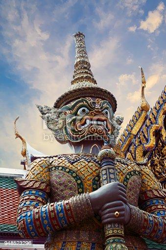 Detail of Thotsakhirithon, giant demon (Yaksha) guarding an exit at the Wat Phra Kaew Palace, also known as the Emerald Buddha Temple. Bangkok, Thailand.