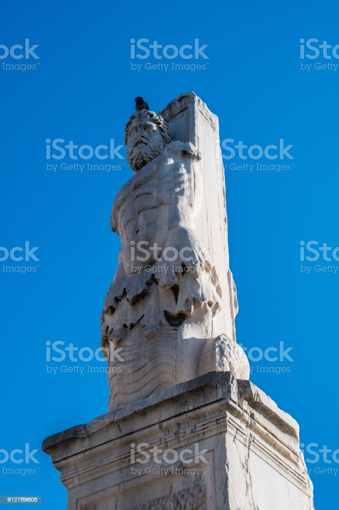 Statue of triton in the odeon of agripa at the ancient agora of Athens Greece stock photo