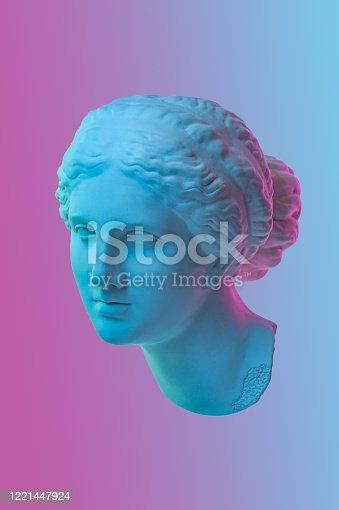 istock Statue of Venus de Milo. Creative concept colorful neon image with ancient greek sculpture Venus or Aphrodite head. Webpunk, vaporwave and surreal art style. Pink and blue duotone effects. 1221447924