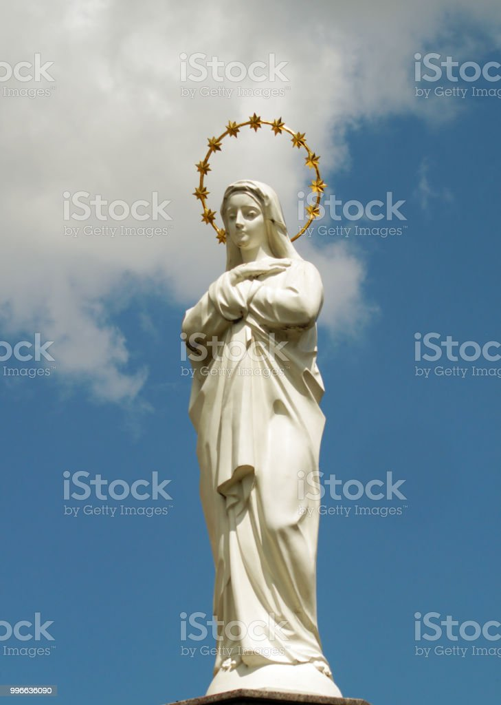 Statue Of Virgin Mary As A Symbol Of Love And Kindness Near Catholic